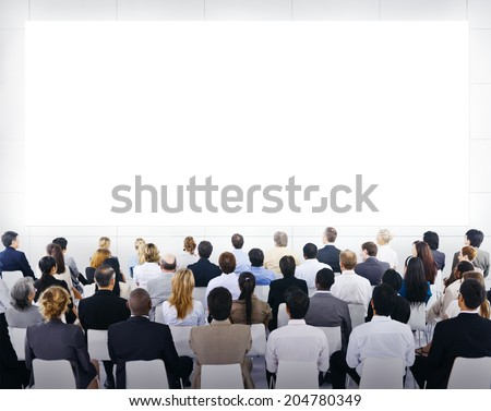 Group of business people sitting and looking at the blank presenation. - stock photo