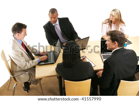 Group of business people sitting around a table and working. - stock photo