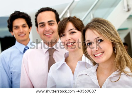 Group of business people smiling at an office