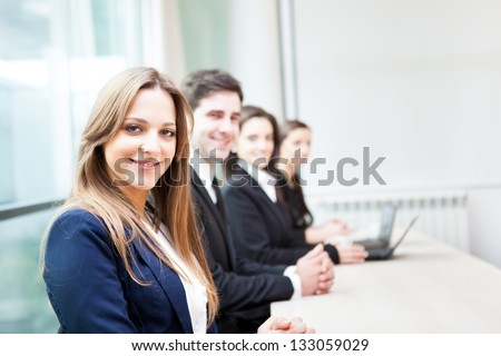 Group of business people smiling at the office lined up - stock photo