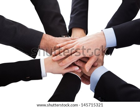 Group Of Business People Stacking Hand Over Each Other On White Background