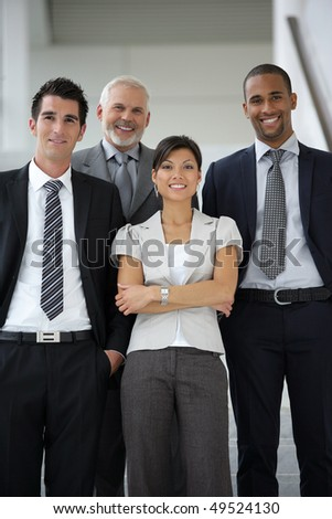 Group of business people standing in a hall