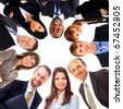 Group of business people standing in huddle, smiling, low angle view - stock photo