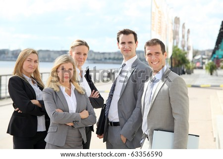 Group of business people standing outside a trade fair - stock photo