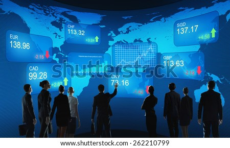 Group of business people standing with back against market background - stock photo
