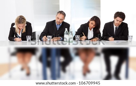 Group of business people taking notes at the meeting