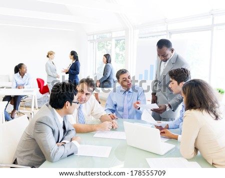 Group of Business People Talking around Conference Table