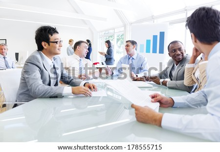 Group of Business People Talking at Conference Table