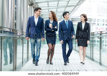 Group of business people talking to each other - stock photo