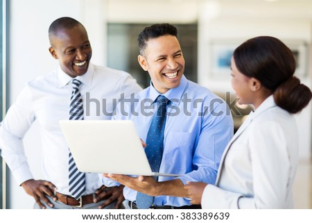 group of business people using laptop in modern office - stock photo