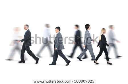 Group of Business People Walking in Different Directions  - stock photo
