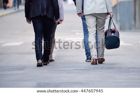 Group of business people walking in troup