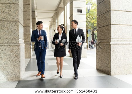 Group of business people walking on the street - stock photo