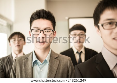 Group of business people with businessman leader on foreground.Asian