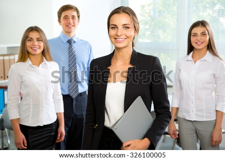 Group of business people with businesswoman leader on foreground - stock photo