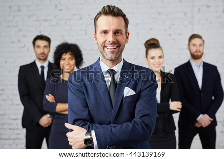 Group of business people with leader at front - stock photo