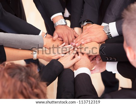Group Of Business People With Their Hands Together - stock photo