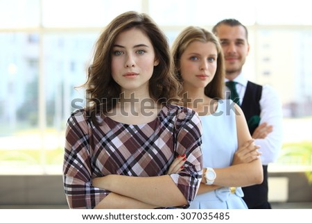 Group of business people with two young beautiful business ladies and a business man - stock photo