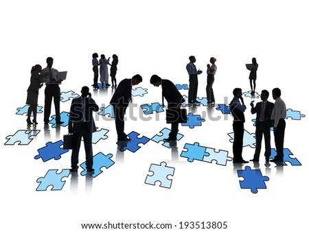 Group Of Business People Working And Standing On Jigsaw Puzzles
