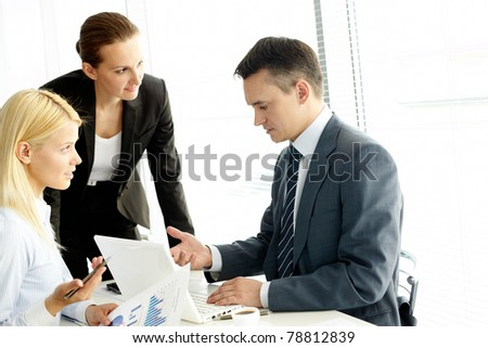 Group of business people working at meeting - stock photo