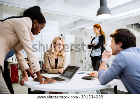 Group of business people working in office and discussing new ideas - stock photo