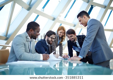 Group of business people working in team at the table - stock photo