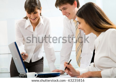 Group of business people working on laptop with their manager at the office - stock photo