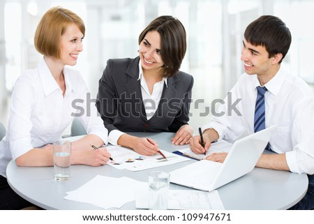 Group of business people working together at a meeting