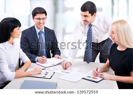 Group of business people working together in an office - stock photo