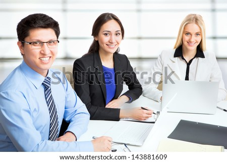 Group of business people working together in an office