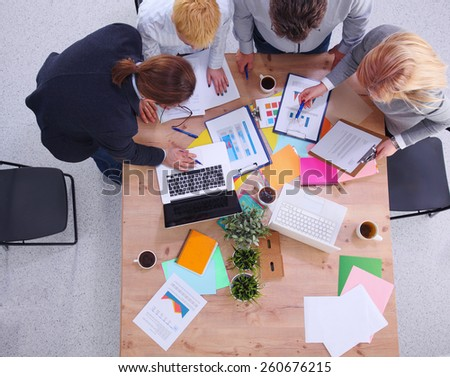 Group of business people working together in office - stock photo