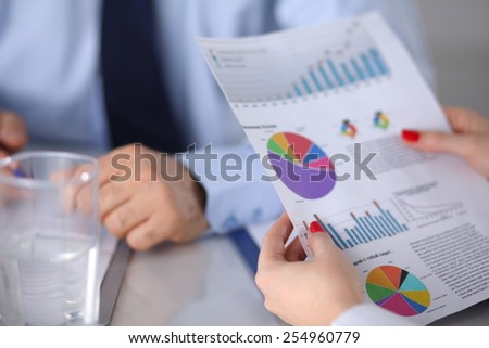 Group of business people working together on white background - stock photo