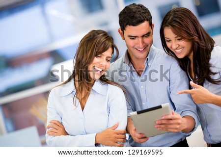 Group of business people working with a tablet computer
