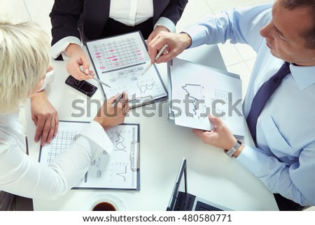 Group of business people working with new investment plans