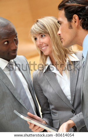 Group of business team meeting in hall - stock photo