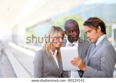 Group of business team meeting outside - stock photo