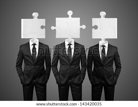 group of businessman with puzzle pieces instead heads - stock photo