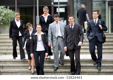 Group of businessmen and businesswomen - stock photo