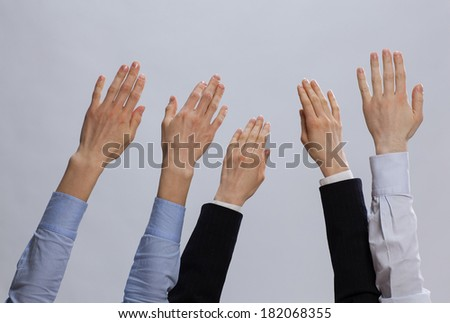 Group of businessmen holding hands up - closeup shot