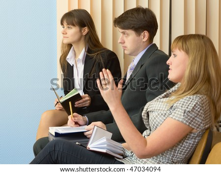 Group of businessmen sitting on armchairs - stock photo