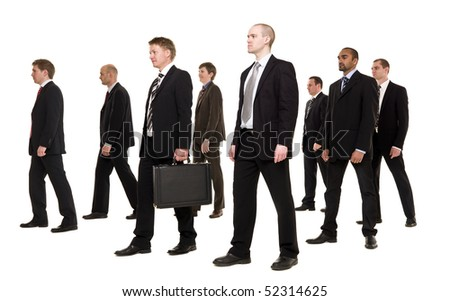 Group of businessmen walking in the same direction - stock photo