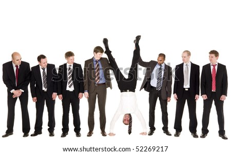 Group of businessmen with the boss upside down