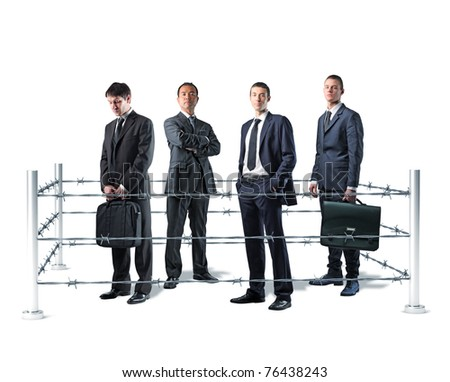 group of businesspeople and barbed wire fence - stock photo