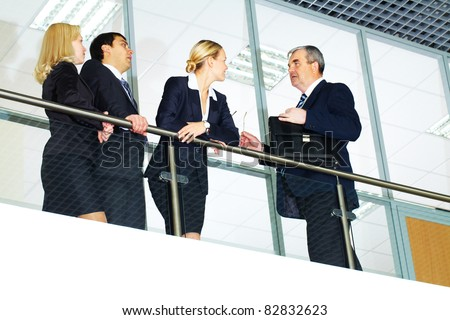 Group of businesspeople and their senior boss interacting - stock photo