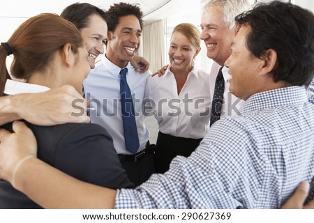 Group Of Businesspeople Bonding In Circle At Company Seminar - stock photo