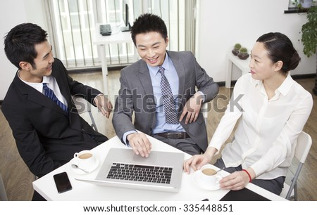 Group of businesspeople chatting in office