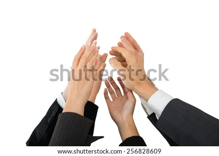 Group Of Businesspeople Giving High-five Over White Background