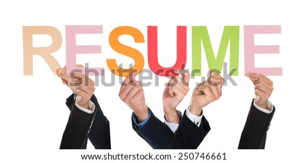 Group Of Businesspeople Hands Holding The Word Resume Over White Background - stock photo