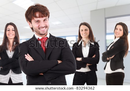 Group of businesspeople in the office. Their leader is on the front. - stock photo