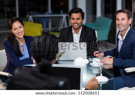Group of businesspeople interacting with each other in a meeting in the office